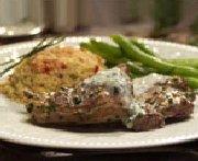 Bifteck de contre-filet et langoustines à l'ail, coulis de tomates à la provençale