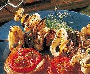 Calmars et moules grillés sur lit de légumes au miel