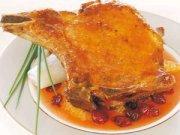 Côtelettes de porc au cari rouge, sauce à l'orange